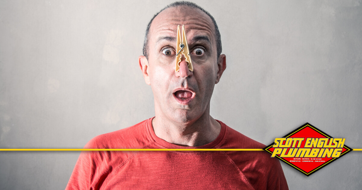 How to eliminate drain odor banner image featuring man with clothespin on nose
