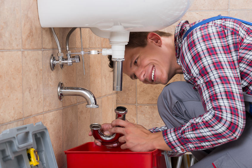 An image of our plumbers fixing an emergency in San Clemente.